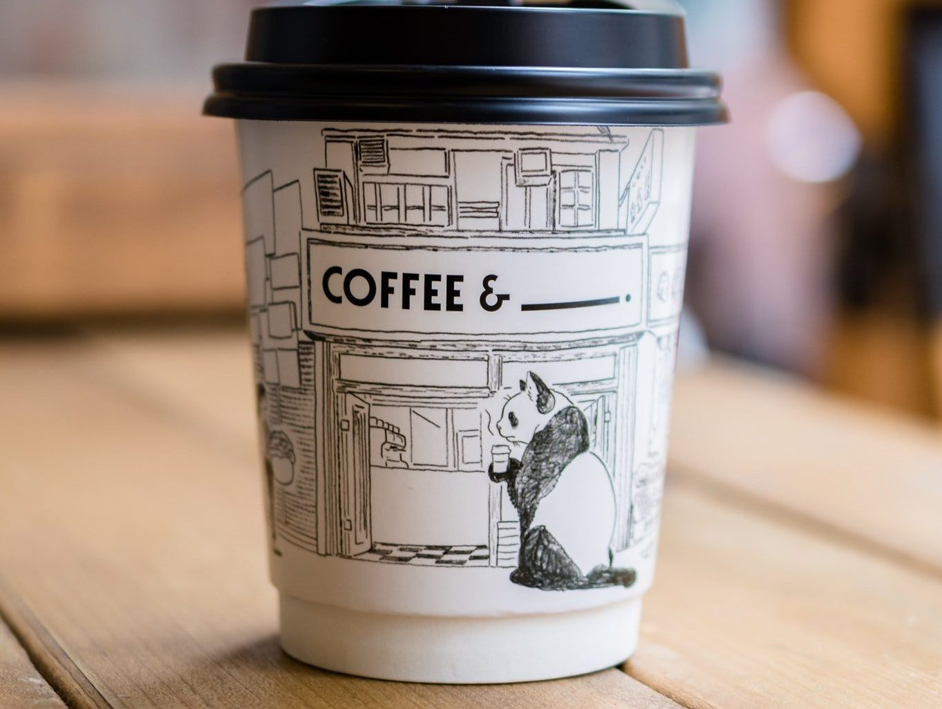 Coffee cup with a panda illustration